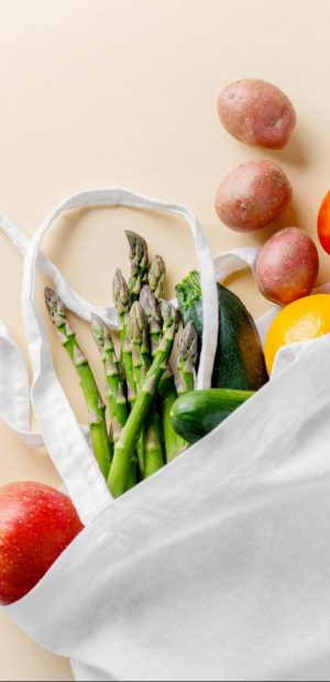 Zero waste concept. Vegetables in textile bag. No plastic. Bright Background. Clever consuming, healthy planet concept.